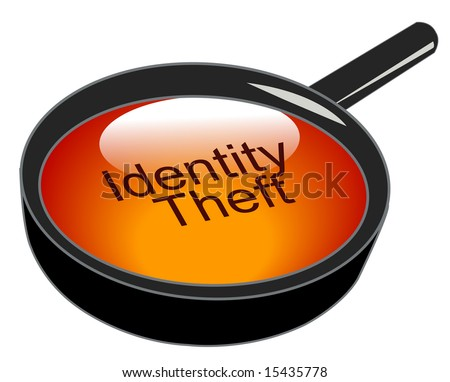magnifying glass over top of identity theft