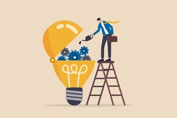Maintenance brain to generate idea or creativity and innovation to invent new business ideas concept, businessman drop lubricant or grease into open lightbulb lamp with mechanical gears.