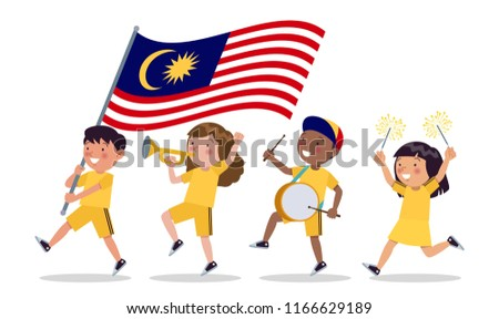 Malaysian children of various tribes are parading commemorating and celebrating the Independence day of Malaysia