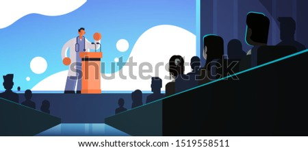 male doctor in white coat giving speech from tribune with microphones medicine healthcare concept people group silhouettes conference meeting seminar flat horizontal