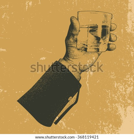 male hand holding a glass of