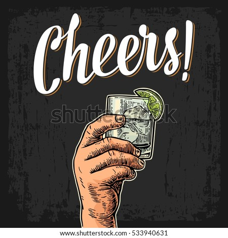 Male hand holding a glass with gin, lemon and ice cubes. Cheers toast lettering. Vintage vector color engraving illustration for label, poster, invitation to a party. Isolated on dark background.