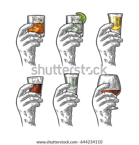 male hand holding a glass with...