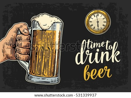 male hand holding glass beer