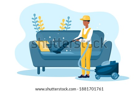 Male housekeeper in yellow overall vacuum cleaning sofa. Janitor with vacuum cleaner. Concept of janitorial service, housekeeping chores. Flat cartoon vector illustration