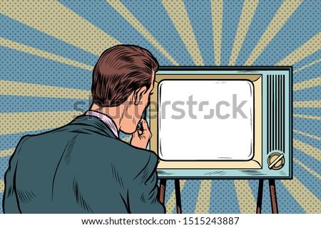 male viewer watching TV. Television propaganda, film and news. Pop art retro vector illustration drawing ストックフォト ©