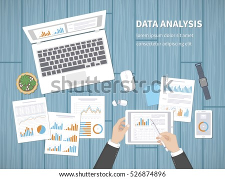 Man analyzes documents. Accounting, analytics, analysis, report, research, planning concept. Hands on the desktop hold tablet. Charts, diagrams, graphs on the paper. Office space top view.