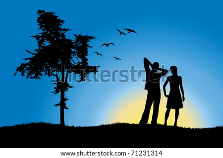 man and girl standing on hill