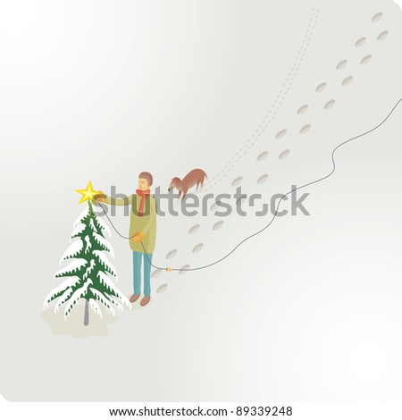 Man and his dog is building a star light on the top of a tree into the snow. Scene view from an higher point.