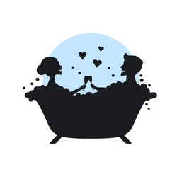 man and woman, romantic couple in love in a bathtub taking bubbled bath silhouette