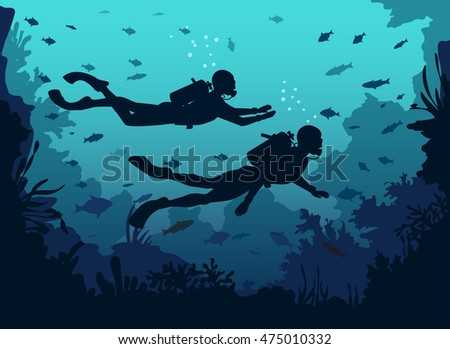 man and woman scuba divers