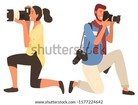 Man and woman shooting, people focusing on object. Photographers characters in casual clothes with cameras, male and female photographing, hobby vector