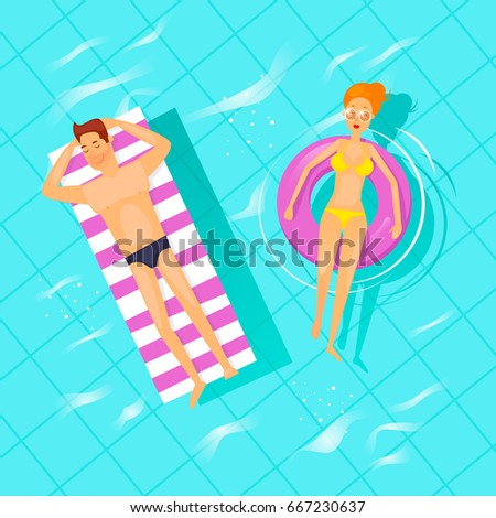man and woman swimming on