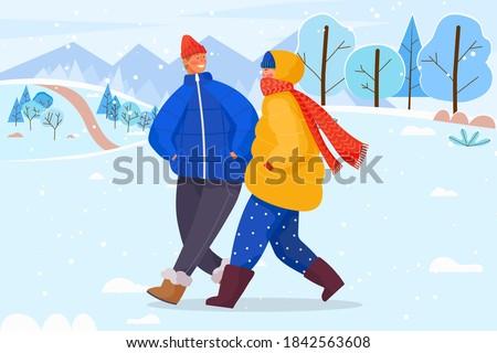 man and woman walking and