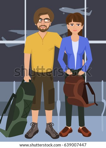 man and woman with rucksacks at