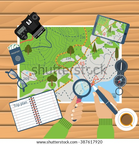 man at table with map and