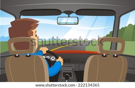 man driving a car through a