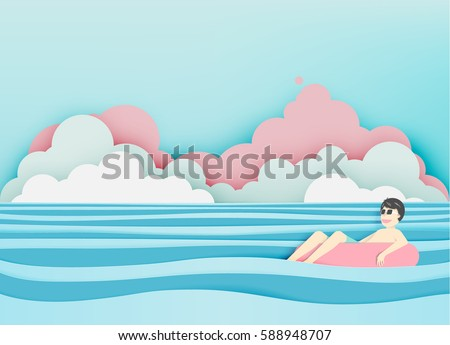 man floating on the beach with