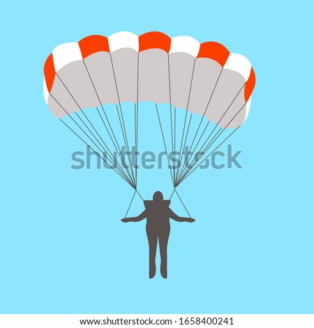 man goes down on a parachute