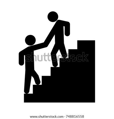 man helping climb other man...