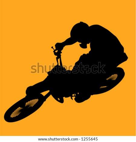 man hitting jump on dirt bike
