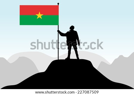 man holding a flag of Burkina Faso, vector
