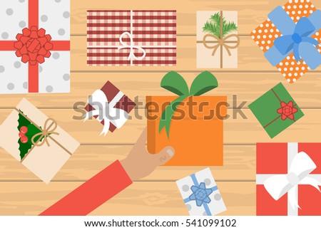 man holding christmas presents