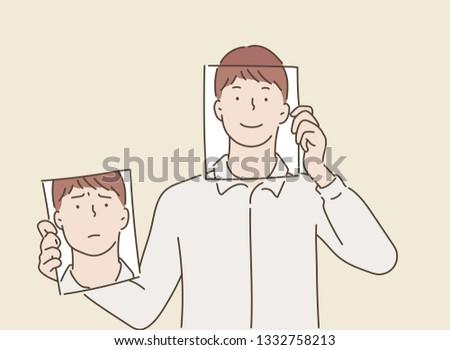 man holding two white photo
