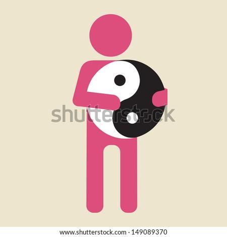 man holding yin and yang symbol