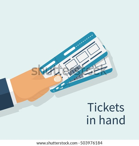 man holds tickets in hand flat