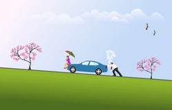 Man is pushing a broken car up the hill with a woman sitting on the hood of the car holding an umbrella. Blue sky background
