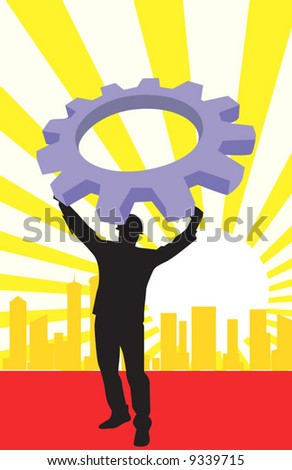 man lifting a machine wheel in background of silhouette of buildings