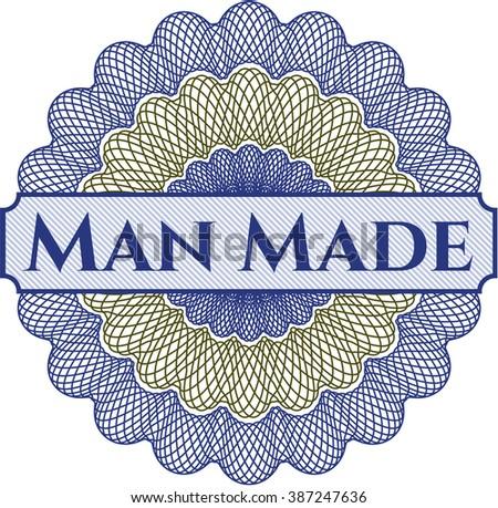 Man Made rosette or money style emblem