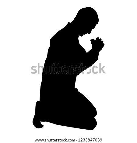 man pray on his knees