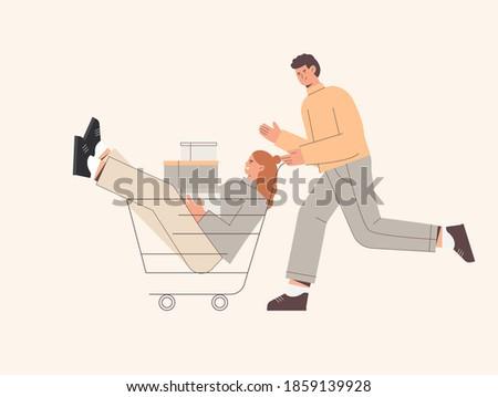 man push shopping cart with