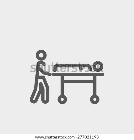 man pushing the stretcher with