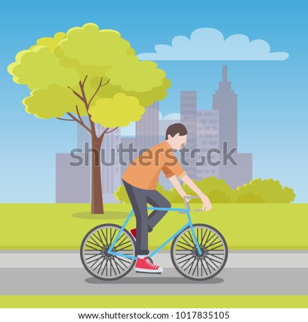man rides bicycle along road