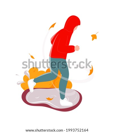 Man running under falling autumn leaves, bad windy weather