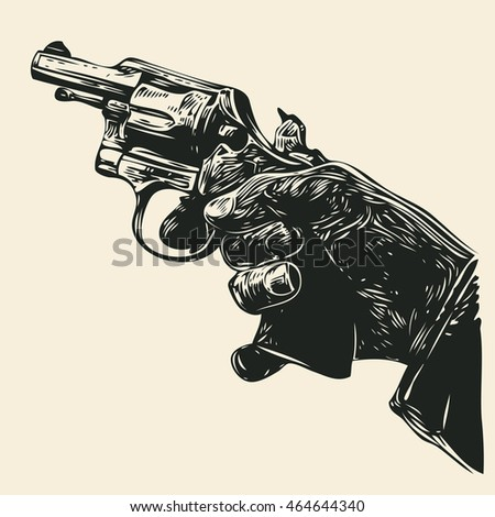 man's hand with a revolver
