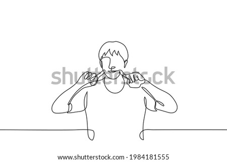 man shows his cute side - one line drawing. playful guy pokes his index fingers into his cheeks and smiles. korean gesture to show off your sweetness and childishness Stok fotoğraf ©