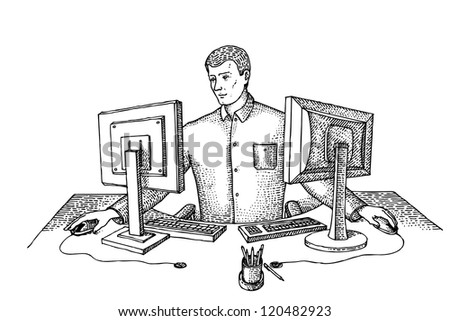 Man sits in the office at two computers