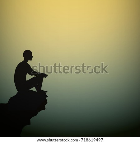 man sits on the  rock look at