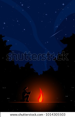 Stock Photo man sitting next to campfire in forest at night with stars in the sky