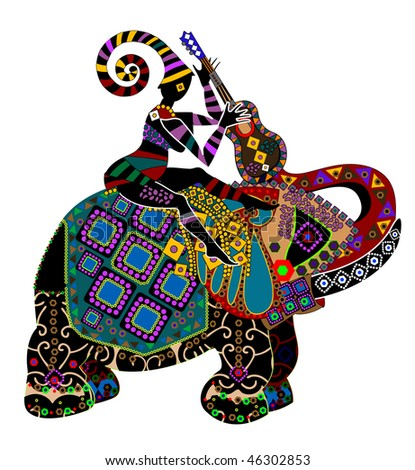 man sitting on the back of a big elephant in ethnic style