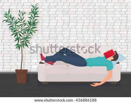 Man sleeping on the couch sofa with book covering his face. Tired student fall asleep