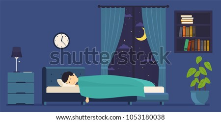 Man sleeps at night in bed. Room with a window at night.