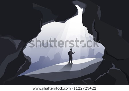 man standing in big caves