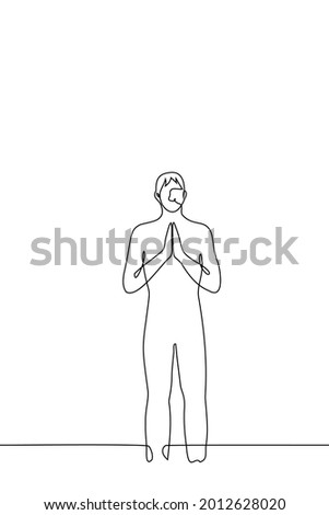 man stands with his hands folded vertically, palms facing each other - one line drawing. concept of a benevolent greeting in many cultures, prayer, meditation  Stock photo ©