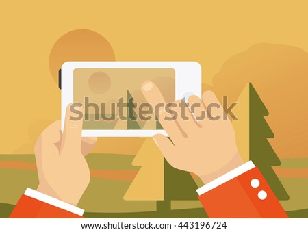 man taking landscape photo with