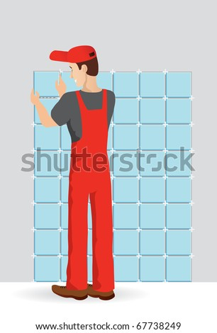Man tiling a wall in the room